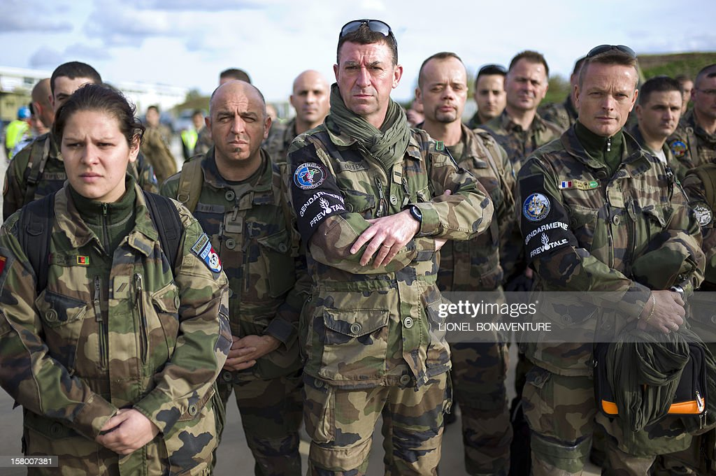 French soldiers listen to unseen French Defence Minister, Jean-Yves Le Drian at Paphos airport in Cyprus in December 8, 2012 before leaving for France. Le Drian today welcomed some 150 French soldiers returning from Afghanistan.