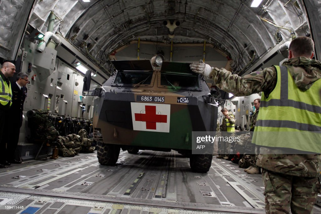 French soldiers load a armoured VAB sanitary vehicle in a British army Boeing C-17 cargo aircraft arriving from British Brize Norton base en route to Bamako, on January 13, 2013 at the Evreux military Base. Britain supports France's decision to send troops to support an offensive by Mali government forces against Islamist rebels.