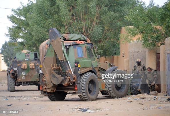 French soldiers load a homemade bomb containing 600 kilos of explosives on a military excavator after defused it on February 13 2013 in a courtyard...