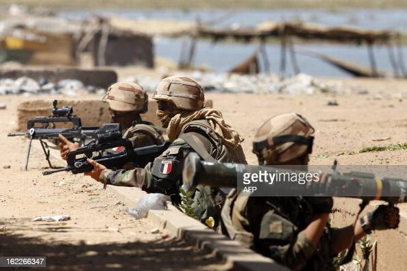 French soldiers man their positions while clashes erupted in the city of Gao on February 21 2013 and an apparent car bomb struck near a camp housing...