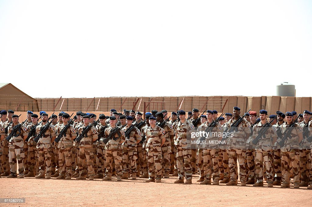 French soldiers of Barkhane counterterrorism operation in Africa's Sahel region wait for the arrival of France Prime Minister and France Defense...