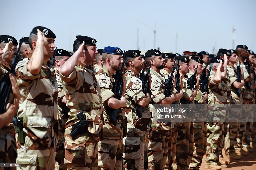 French soldiers of Barkhane counterterrorism operation in Africa's Sahel region salute France Prime Minister and France Defense Minister upon their...