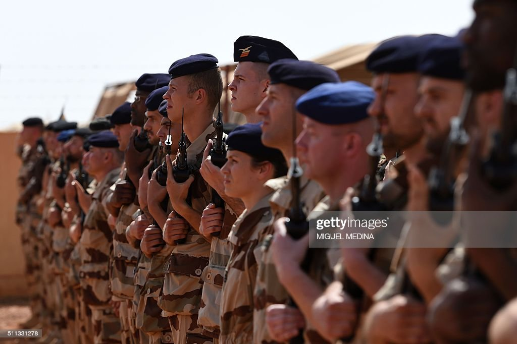 French soldiers of Barkhane counterterrorism operation in Africa's Sahel region wait for the arrival of France Prime Minister Manuel Valls and France...