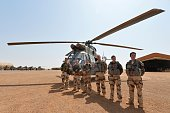 French soldiers of Barkhane counterterrorism operation in Africa's Sahel region are pictured in front of their Caiman war helicopter before the visit...