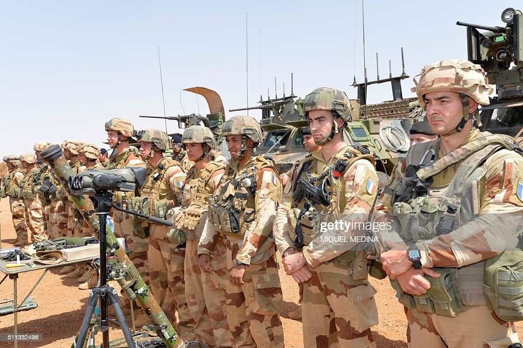 French soldiers of Barkhane counterterrorism operation in Africa's Sahel region are pictured next to their weapons before the visit of France Prime...