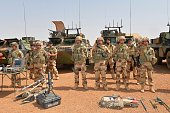 CORRECTION French soldiers of Barkhane counterterrorism operation in Africa's Sahel region are pictured next to their weapons before the visit of...