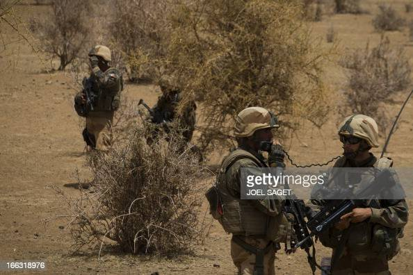 French soldiers of the 92nd Infantery Regiment take part on April 10 105 kms north of the northeastern Malian city of Gao in day three of Operation...