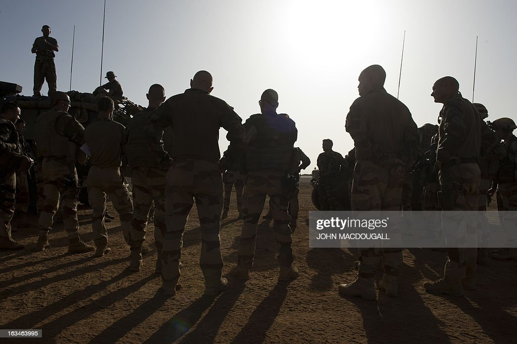 French soldiers of the 92nd Infantry Regiment (92eme R.I) are briefed by their commanding officer in Gao on March 10, 2013, before heading out to a village north of Gao to assess the needs of the local population there.