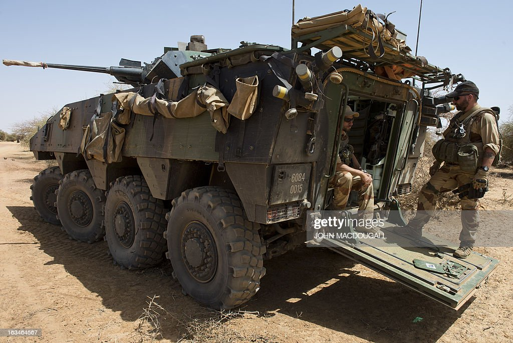 French soldiers of the 92nd Infantry Regiment (92eme R.I) pause in their armoured personnel carrier (VBCI) as a French military convoy makes its way to the village of Amakouladji north of Gao on March 10, 2013, to assess the needs of the local population there.