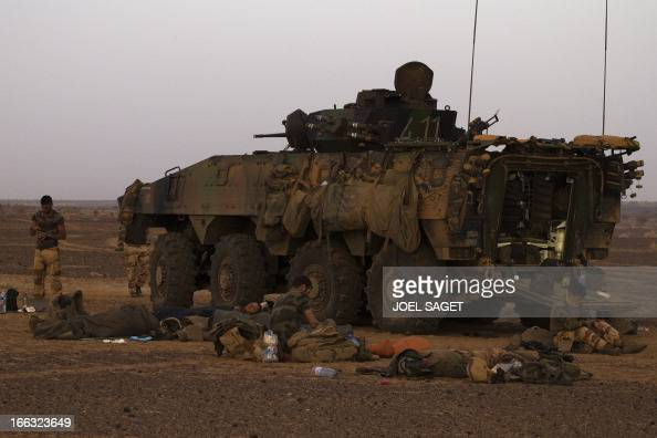 French soldiers of the 92nd Infantry Regiment wake up early on April 10 105 kms north of the northeastern Malian city of Gao in day three of...