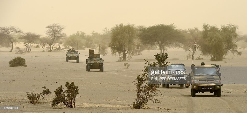 French soldiers of the 93rd French Mountain Artillery Regiment and FAMA ride on June 4 2015 on the Faguibine dry lake near Bintagoungou in the...