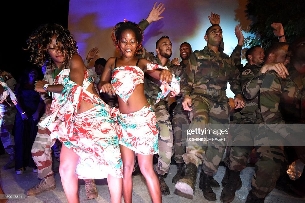 French soldiers of the Barkhane Operation celebrate on December 31 the New Year with during a visit to the Kosseï French military camp in NDjamena on...