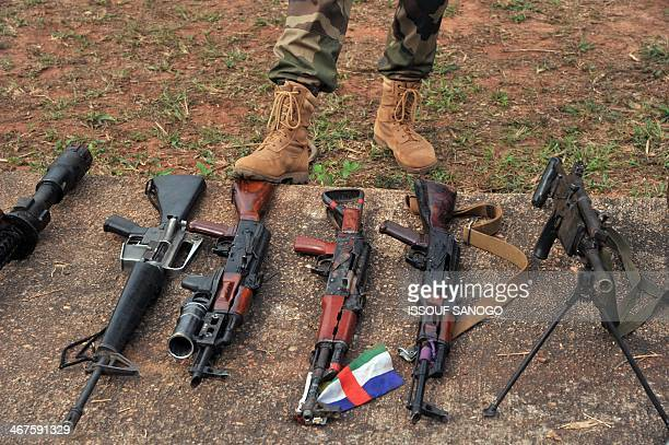 French soldiers of the Sangaris military operation show to journalists weapons seized from Christian vigilantes known as 'antibalaka' and exrebels...