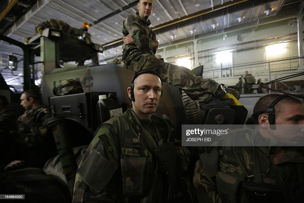 French soldiers on a commando carrier on the back of a BPC Tonnerre assault helicopters carrier prepare take part in sea and land war games with the Lebanese forces on the bay of Jounieh, north of Beirut, on March 26, 2013.