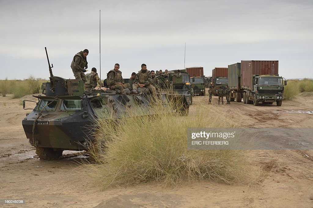 French soldiers on armoured vehicles followed by a logistic convoy make a stop in the desert on their way to the city of Timbuktu on January 28, 2013. Hundreds of people gave French-led troops a hero's welcome on Monday as they entered the historic city of Timbuktu, occupied for 10 months by Islamists who imposed a harsh form of sharia.