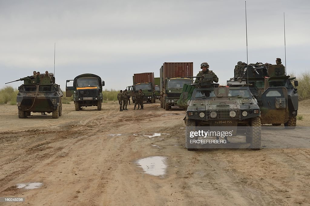 French soldiers on armoured vehicles make a stop in the desert on their way to the city of Timbuktu on January 28, 2013. Hundreds of people gave French-led troops a hero's welcome on Monday as they entered the historic city of Timbuktu, occupied for 10 months by Islamists who imposed a harsh form of sharia.