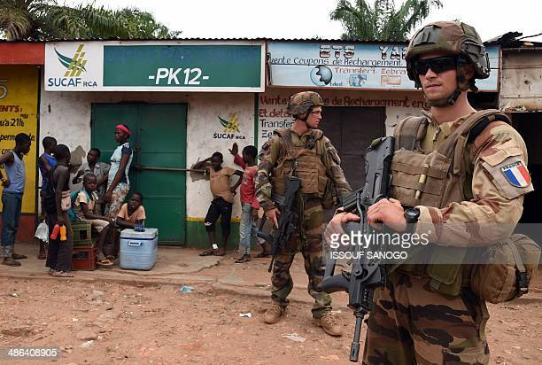 French soldiers part of the Sangaris operation patrol near the mosque where muslims are gathered in the PK12 neighbourhood in Bangui on April 24 2014...
