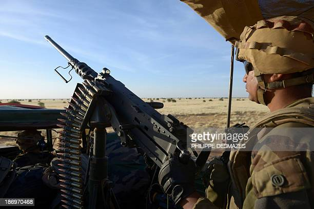 French soldiers patrol as part of the Hydra Operation on October 30 in a desert near the village of Bamba between Timbuktu and Gao northern Mali The...