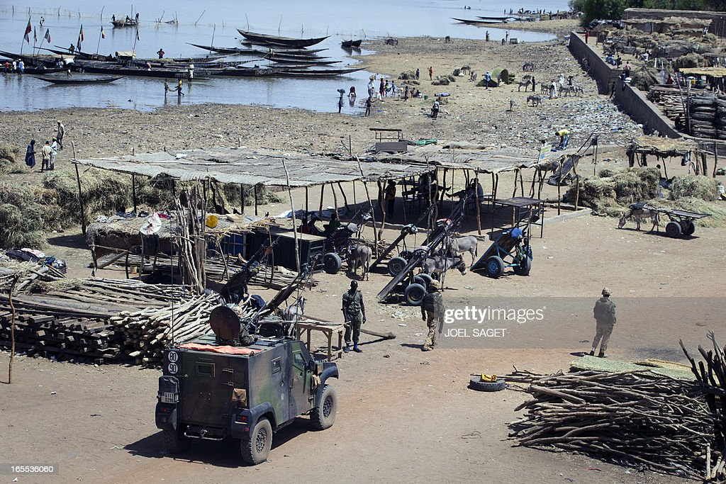 French soldiers patrol at Gao's port near the Niger river on April 4 2013 The United Nations expressed concern over reprisal attacks against ethnic...