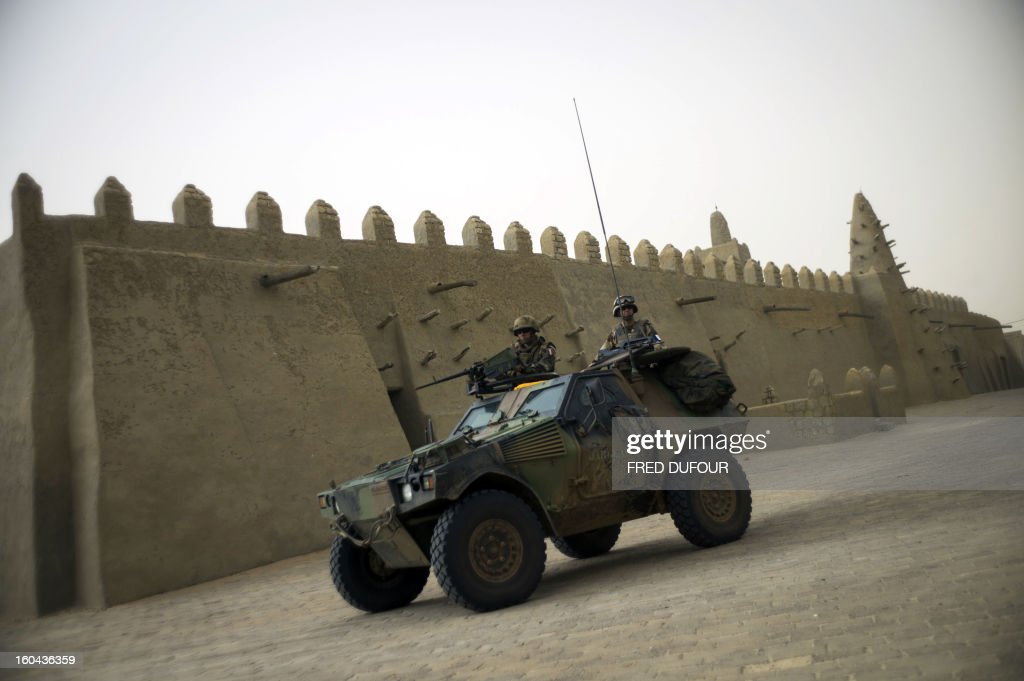 French soldiers patrol in an armoured vehicle next to the Djingareyber mosque, on January 31, 2013 in Timbuktu. The fabled desert city of Timbuktu, an ancient centre of Islamic learning, has been recaptured on January 28 by French-led forces in their offensive against Islamist rebels who have been occupying Mali's north since last April. The extremists last year smashed up mausoleums of ancient saints and the entrance to the 15th-century Sidi Yahya mosque, claiming the sites were blasphemous. Reports had emerged in recent days that rebels fleeing the advancing soldiers had torched a building housing thousands of priceless manuscripts, but an expert said on January 30 that most had been smuggled to safety as the Islamists overran the city last year.