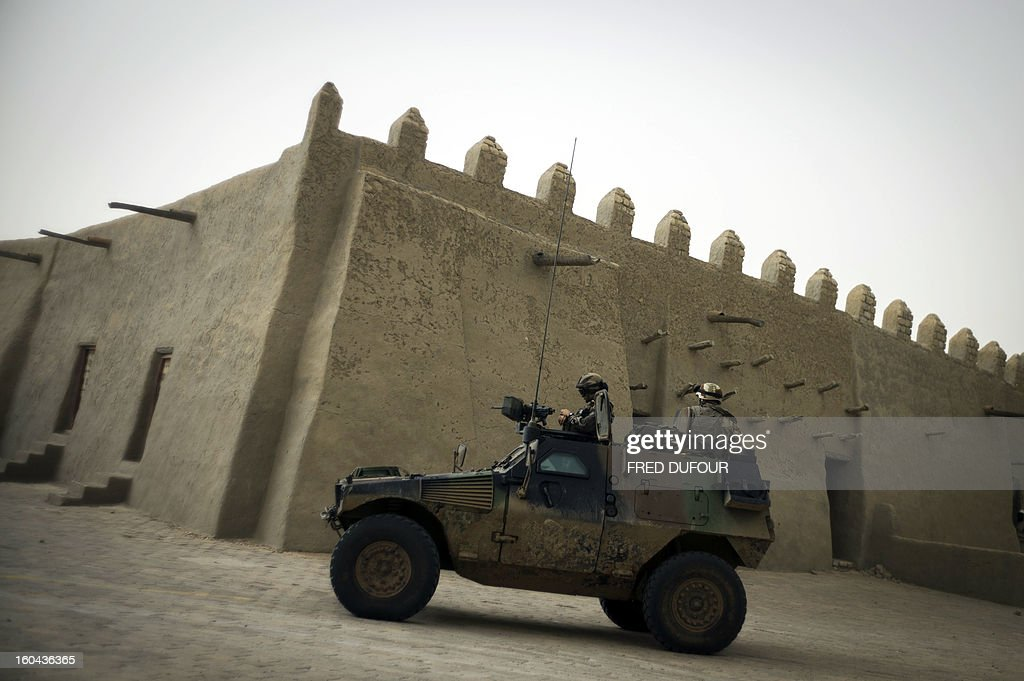 French soldiers patrol in an armoured vehicle next to the Djingareyber mosque, on January 31, 2013 in Timbuktu. The fabled desert city of Timbuktu, an ancient centre of Islamic learning, has been recaptured on January 28 by French-led forces in their offensive against Islamist rebels who have been occupying Mali's north since last April. The extremists last year smashed up mausoleums of ancient saints and the entrance to the 15th-century Sidi Yahya mosque, claiming the sites were blasphemous. Reports had emerged in recent days that rebels fleeing the advancing soldiers had torched a building housing thousands of priceless manuscripts, but an expert said on January 30 that most had been smuggled to safety as the Islamists overran the city last year. AFP PHOTO / FRED DUFOUR