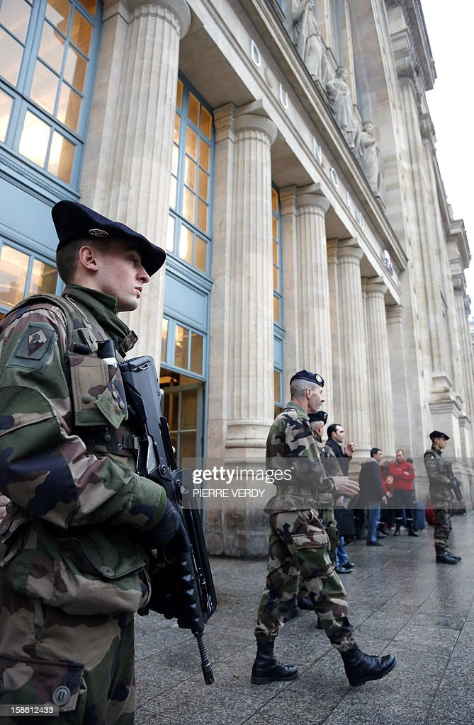 French soldiers patrol in front of Gare du Nord railway station in Paris on December 21, 2012 as part of France's national security alert system 'Plan Vigipirate' which is reinforced for the end of the year celebrations.