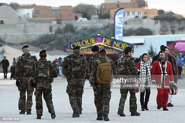 French soldiers patrol in front of MUCEM on December 20 2015 in Marseille southern France as part of security measures following the November 13...