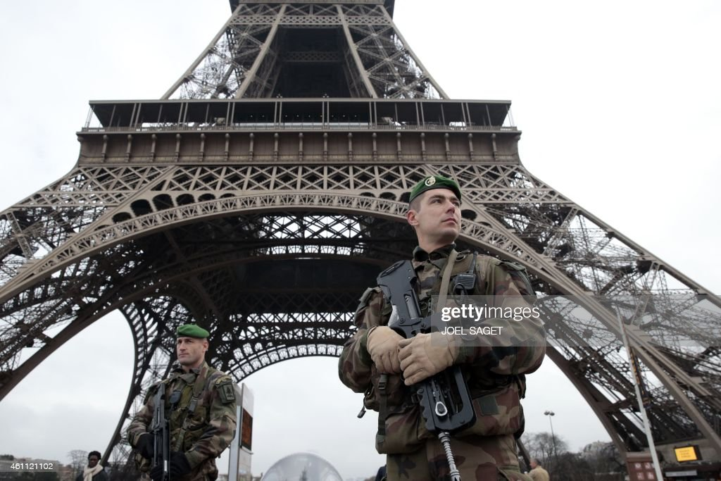 French soldiers patrol in front of the Eiffel Tower on January 7 2015 in Paris as the capital was placed under the highest alert status after heavily...