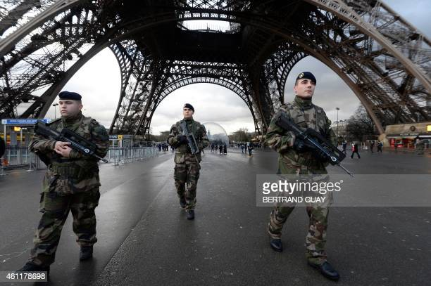 French soldiers patrol in front of the Eiffel Tower on January 8 2015 in Paris as the capital was placed under the highest alert status a day after...