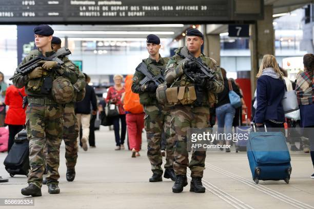 French soldiers patrol in the train station Gare Montparnasse in Paris on October 2 2017 as part of the Sentinelle military force security mission /...