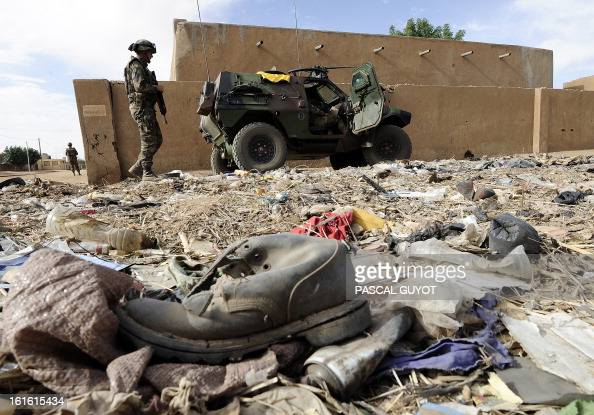 French soldiers patrol near the abandoned house where they fround and defused a homemade bomb containing 600 kilos of explosives on February 13 2013...