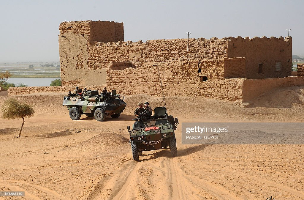 French soldiers patrol on February 17, 2013 in Bourem, northern Mali. A French-led military intervention launched on January 11 has driven the Islamist rebels in Mali from the towns they controlled, but concerns remain over stability amid suicide attacks and guerrilla fighting.