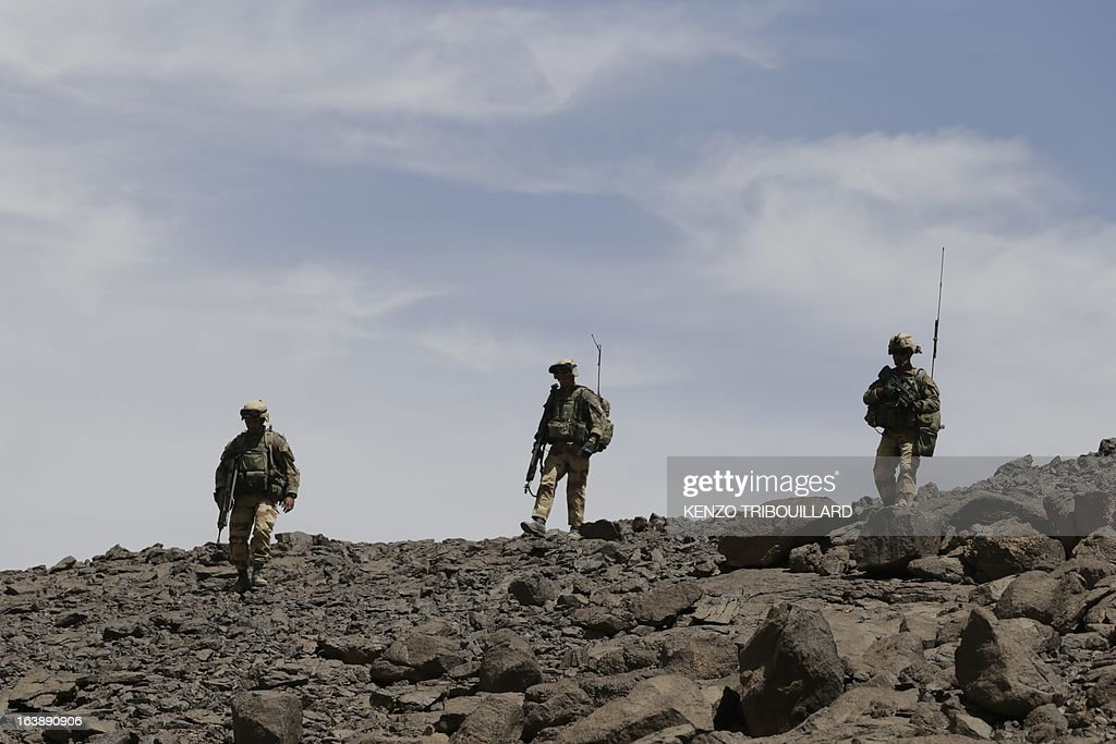 French soldiers patrol on March 17, 2013, in the Adrar of the Ifoghas mountains, northern Mali. A French corporal was killed tracking down jihadist fighters in their northern Mali mountain bastions, bringing to five the number of French deaths since Paris launched a military offensive in the country two months ago. Defence Minister Jean-Yves Le Drian said on March 17, 2013 the 24-year-old soldier was killed and three of his comrades wounded when their vehicle was struck by a roadside bomb blast in the Ifoghas mountains, without saying when it happened. AFP PHOTO / KENZO TRIBOUILLARD AFP PHOTO / KENZO TRIBOUILLARD