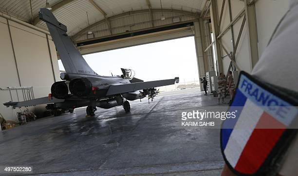 French soldiers prepare a Rafale fighter jet at a military base at an undisclosed location in the Gulf on November 17 as the French army conducts...