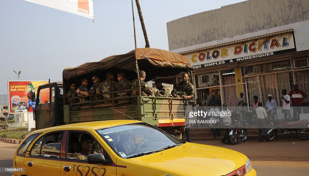 French soldiers sit at the back of a military truck heading down a street in Bangui, on December 31, 2012. Congo announced today the deployment of a battalion of 120 soldiers to the Central African Republic's capital Bangui at the request of the Tchadian President Idriss Deby, who is currently the president of FOMAC. Meanwhile rebels in the Central African Republic vowed to take the last key town before the capital and renewed their call for the president to stand down, voicing scepticism over his pledge to make concessions.