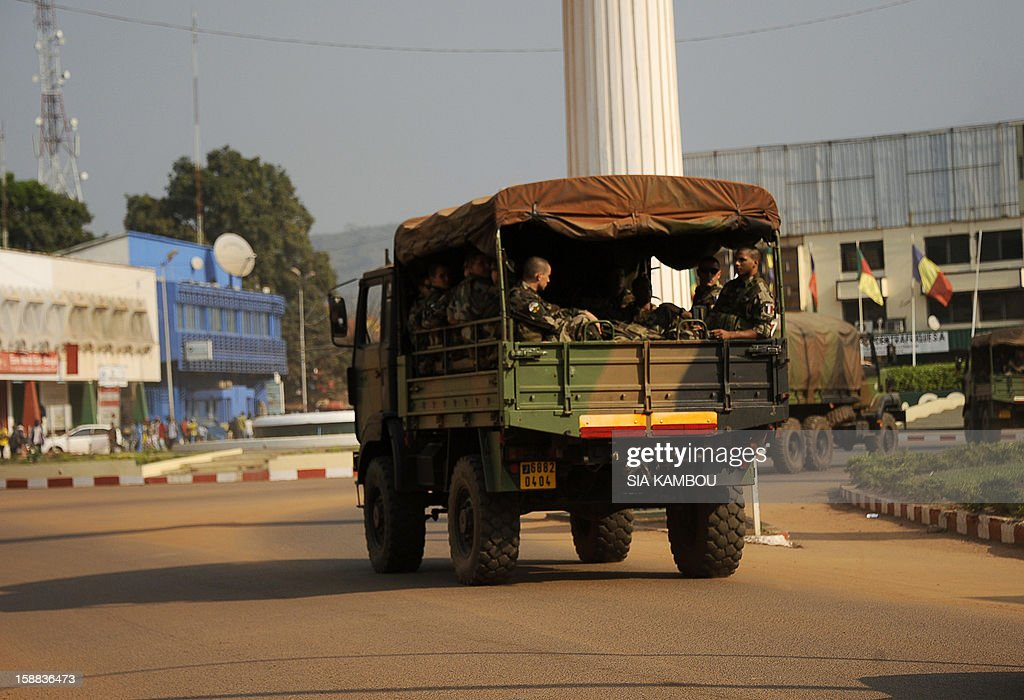 French soldiers sit at the back of a military truck heading down a street in Bangui, on December 31, 2012. Congo announced today the deployment of a battalion of 120 soldiers to the Central African Republic's capital Bangui at the request of the Tchadian President Idriss Deby, who is currently the president of FOMAC. Meanwhile rebels in the Central African Republic vowed to take the last key town before the capital and renewed their call for the president to stand down, voicing scepticism over his pledge to make concessions. AFP PHOTO / SIA KAMBOU