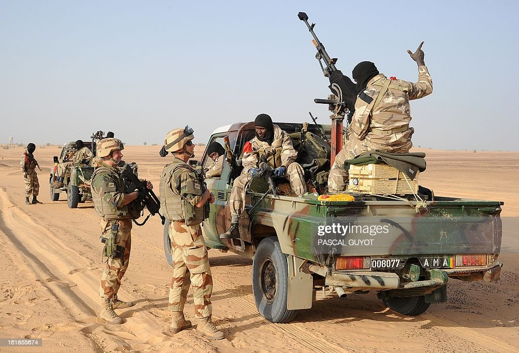 French soldiers speak with Malian soldiers on February 17, 2013 in Bourem, northern Mali. A French-led military intervention launched on January 11 has driven the Islamist rebels in Mali from the towns they controlled, but concerns remain over stability amid suicide attacks and guerrilla fighting.