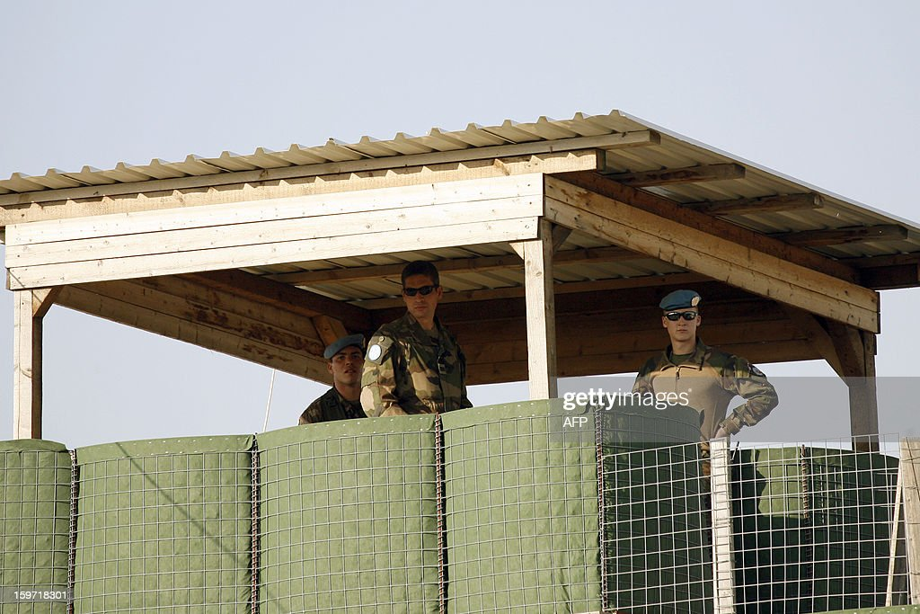 French soldiers stand at an observation tower at the United Nations Interim Force in Lebanon (UNIFIL) French base on January 19, 2013 in the southern city of Deir Kifa.