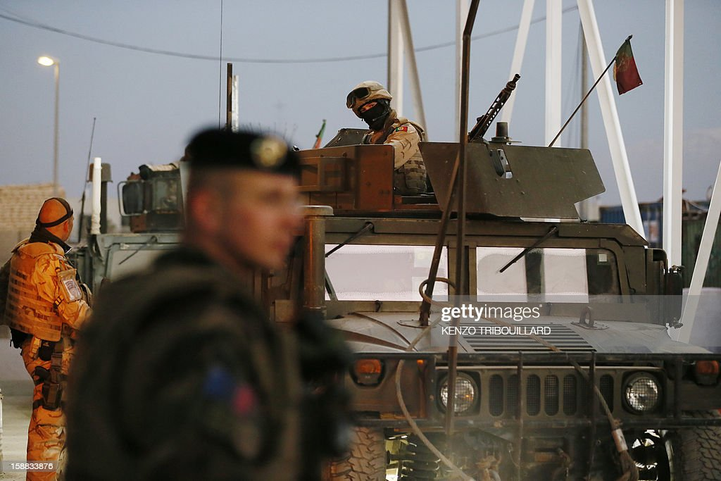 French soldiers stand guard at a check point at Warehouse base in Kabul on December 31, 2012. All French combat troops have now been withdrawn from Afghanistan and only training and logistics personnel remain there.