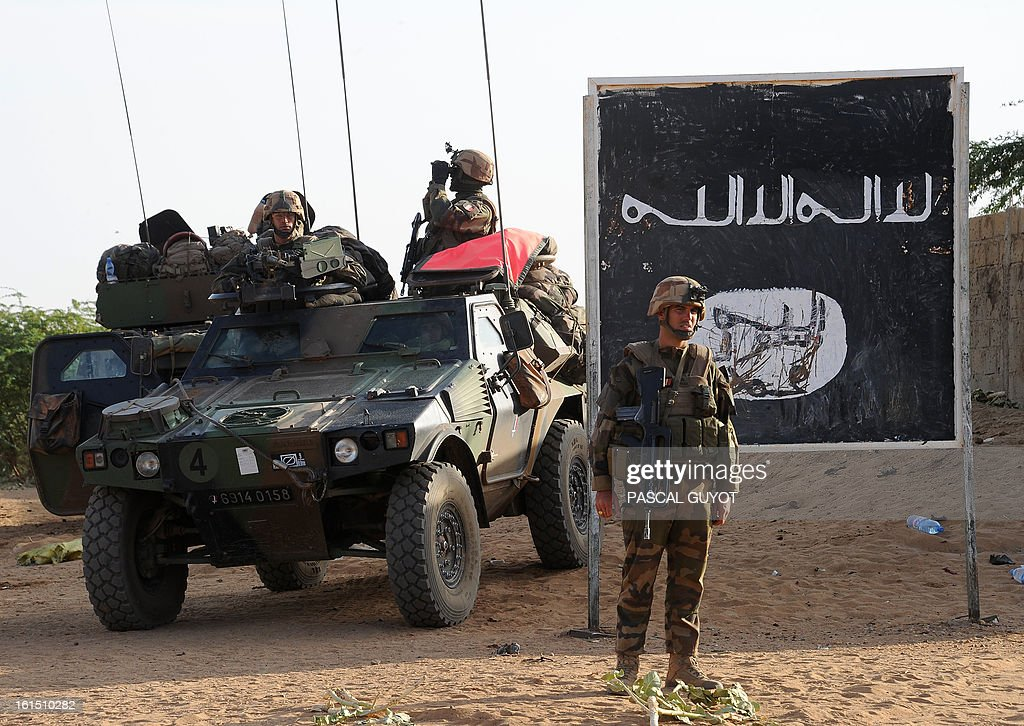 French soldiers stand guard at a check-point set on the road leading to Bourem, on February 11, 2013 in Gao, one day after Islamist gunmen battled French and Malian troops following two straight days of suicide bombings.