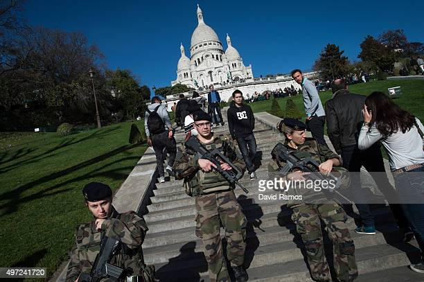 French soldiers stand guard at the 'SacreCoeur' cathedral on November 15 2015 in Paris France As France observes three days of national mourning...