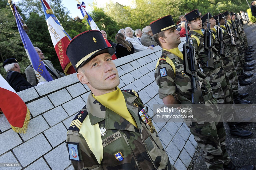 French soldiers stand guard during a ceremony in Tulle, central France, on June 9, 2013, to commemorate the Nazi massacre of Tulle in 1944.