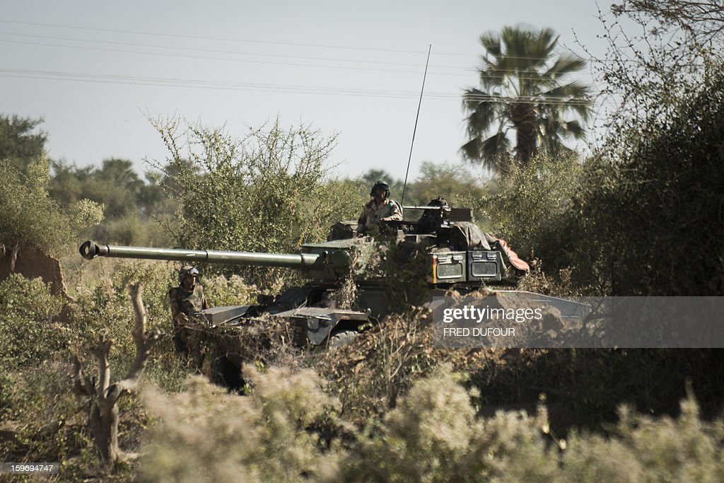 French soldiers stand guard in a tank, on January 18, 2013 in Markala. France confirmed today that Malian troops had taken control of the key central town of Konna from armed Islamists who seized the country's vast desert north in April last year.