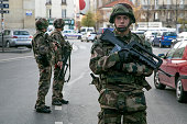 French soldiers stand guard on 'Rue de la Republique' on November 18 2015 in SaintDenis France French Police special forces raided an apartment...