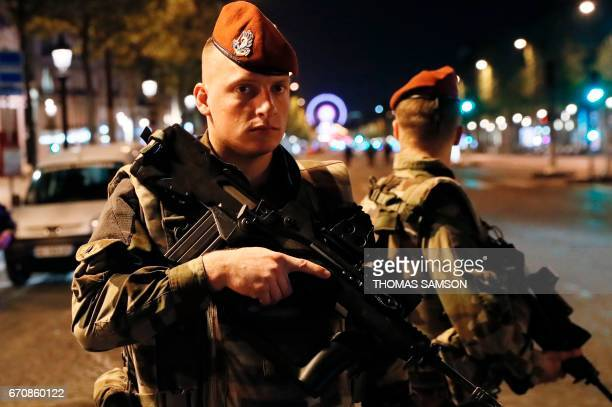 French soldiers stand guard on the Champs Elysees in Paris after a shooting on April 20 2017 One police officer was killed and another wounded today...