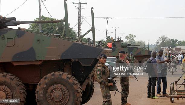 French soldiers stand near armoured personnel carriers during the ceremony marking the power transfer between French Sangaris troops and Centrafrican...