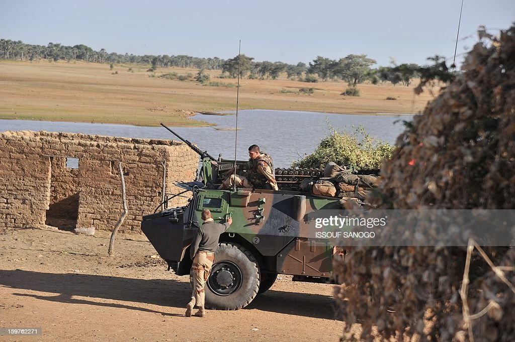 French soldiers stand next to the Niger river on January 20, 2013 near city of Markala, about 260 kms northeast of the capital Bamako and 60 kms. A spokesman for the French military operation codenamed Serval said on January 20 that French forces were advancing towards Mali's Islamist-held north after taking up positions in the towns of Niono and Sevare.