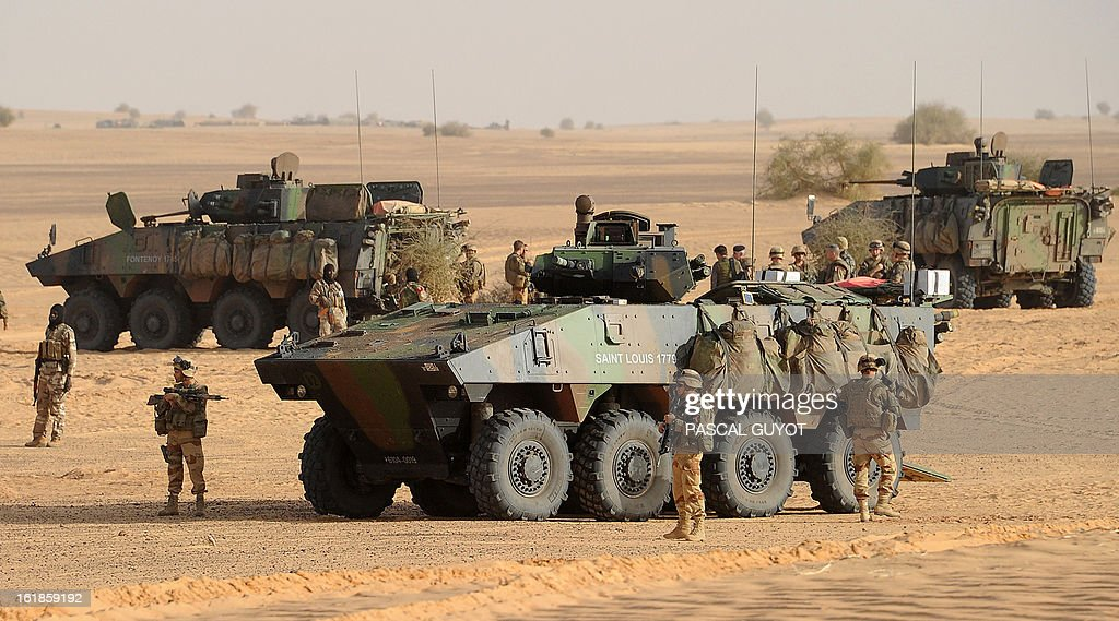 French soldiers stand on February 17, 2013 in Bourem, northern Mali. A French-led military intervention launched on January 11 has driven the Islamist rebels in Mali from the towns they controlled, but concerns remain over stability amid suicide attacks and guerrilla fighting.
