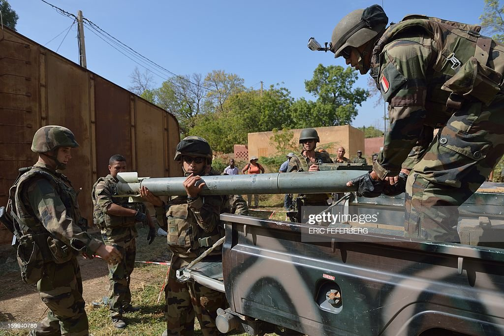 French soldiers unload a rocket they found in an Islamist fighters ammunition stock before destroying it on January 23, 2013 in Diabaly, 400 kilometres (250 miles) north of the capital Bamako. French and Malian troops recaptured the frontline towns of Diabaly and Douentza two days ago in a major boost to their push north to flush out Al Qaeda-linked rebels.