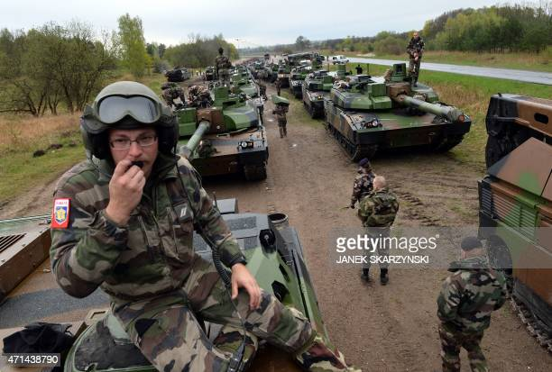 French soldiers unload tanks from a train in Drawsko Pomorskie northern Poland on April 28 2015 Fifteen French tanks and 270 soldiers come to Drawsko...